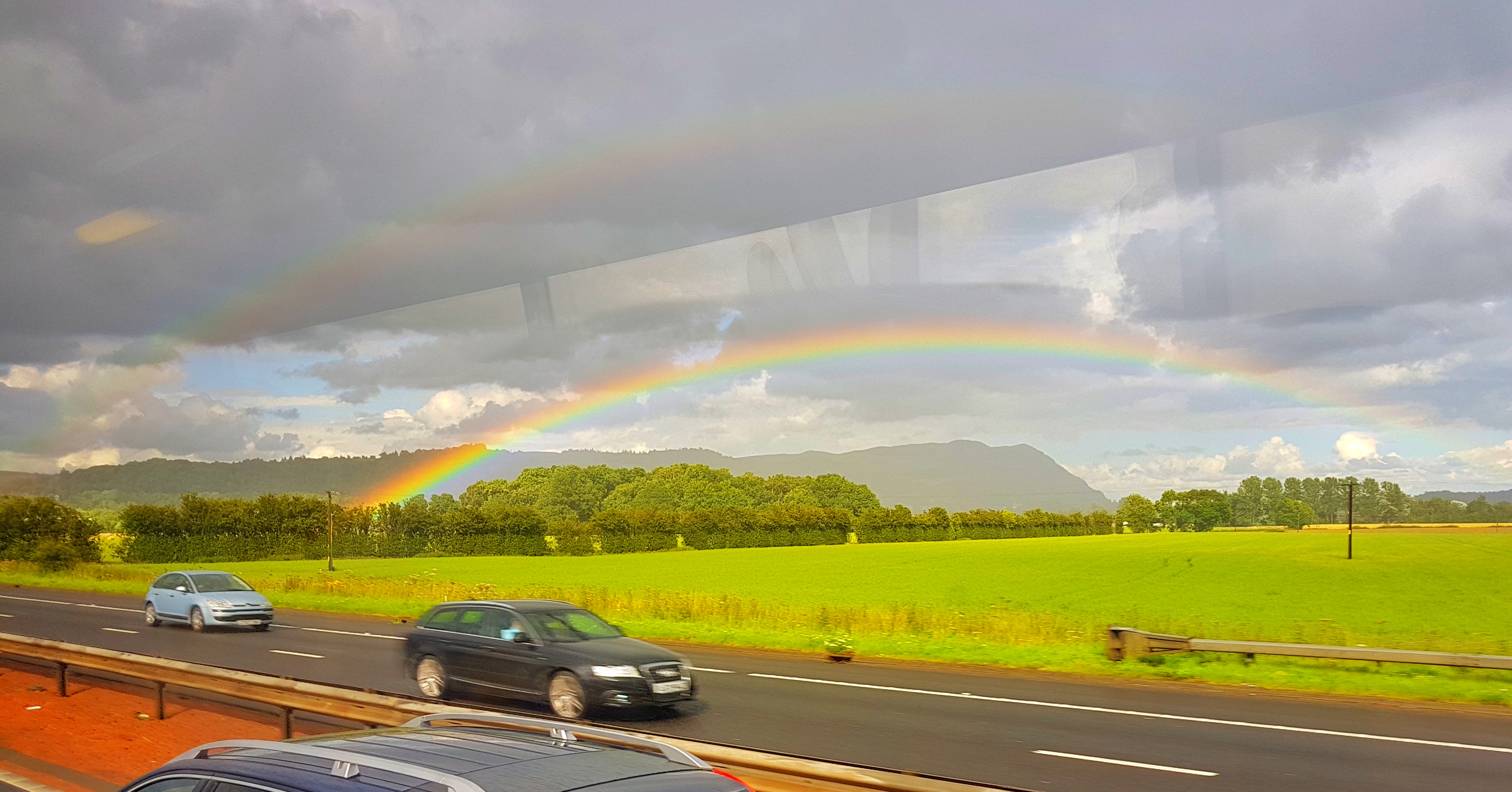 A double rainbow taken by Bill Samson whilst travelling on a bus, taken through the window on a moble phone.  Thanks Bill.