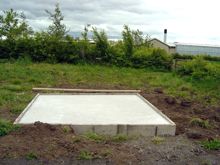 The concrete base is laid.