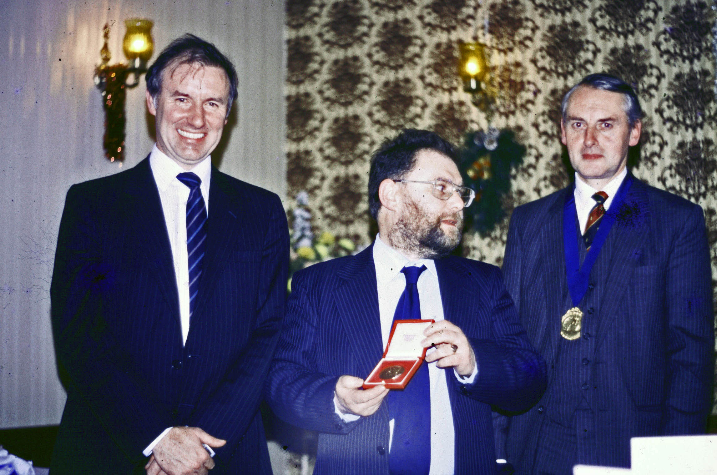 Harry Ford receives the Lorimer Medal while Dave is seen wearing his award. With Prof. Malcolm Longer