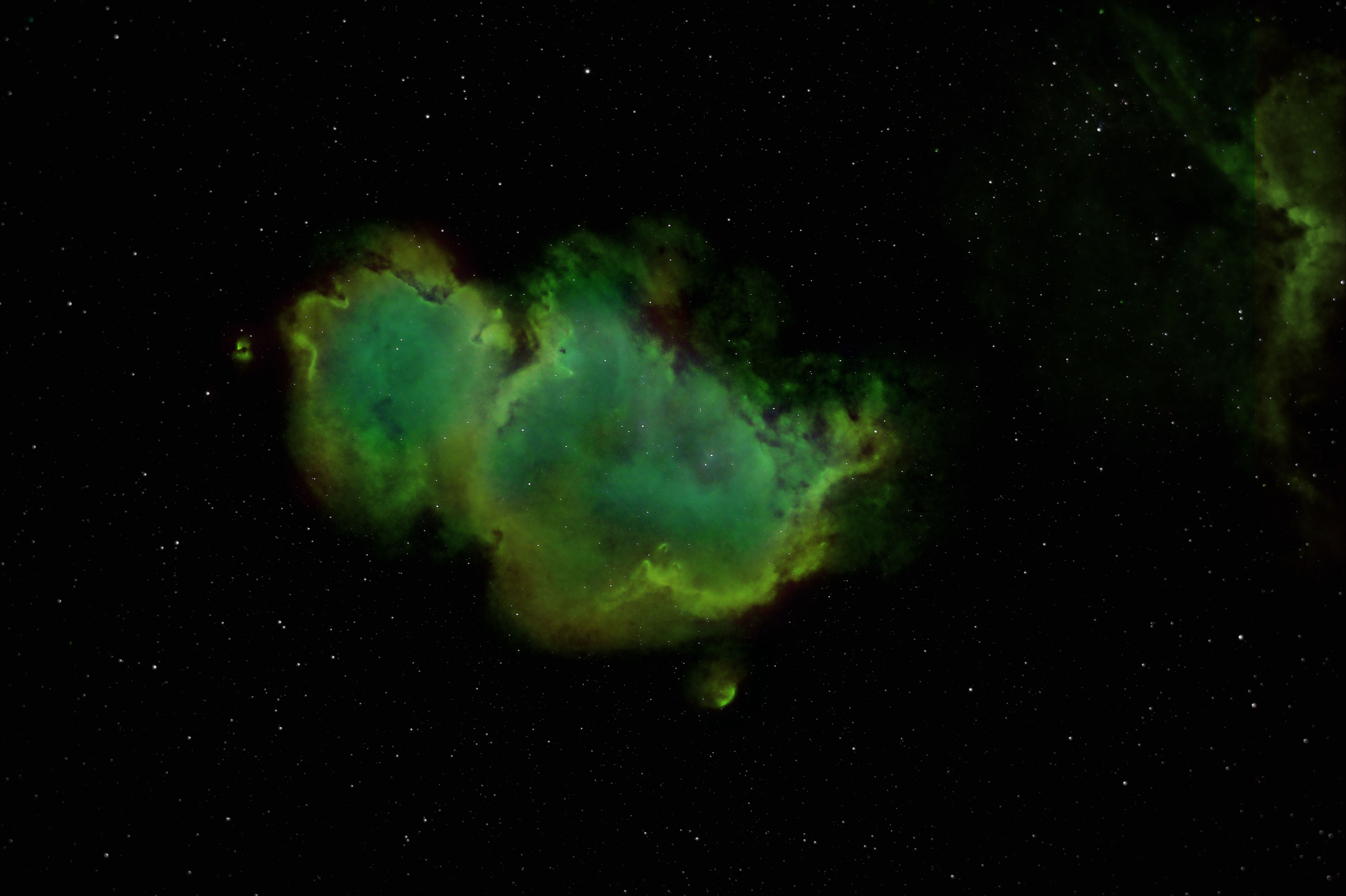 Three views of the same object. It's the Soul or Embryo nebula (IC1848) just next to the Heart Nebula (IC1805).  SII mapped to red, Ha mapped to green and OIII mapped to blue.