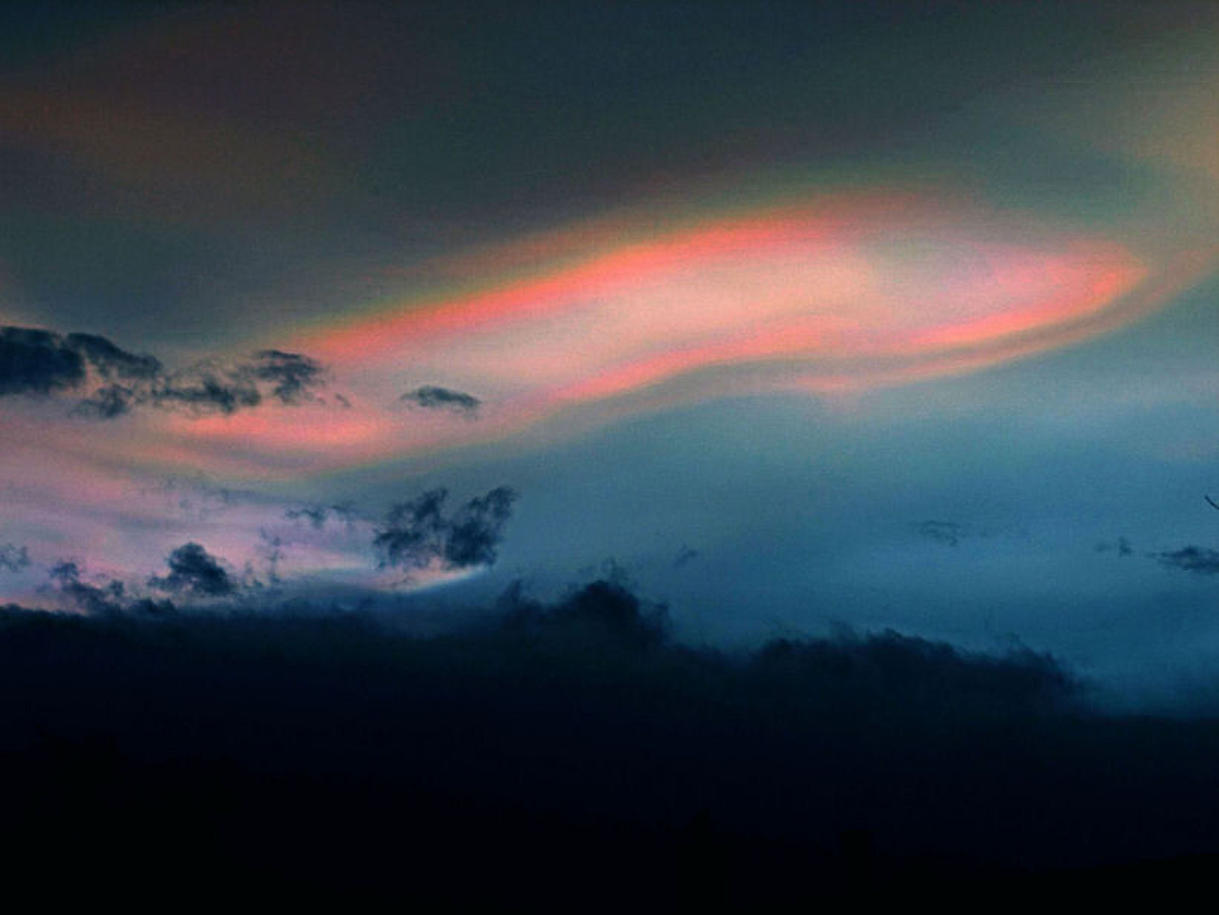 A striking image of Nacreous Clouds by Ken Kennedy with no information available.
