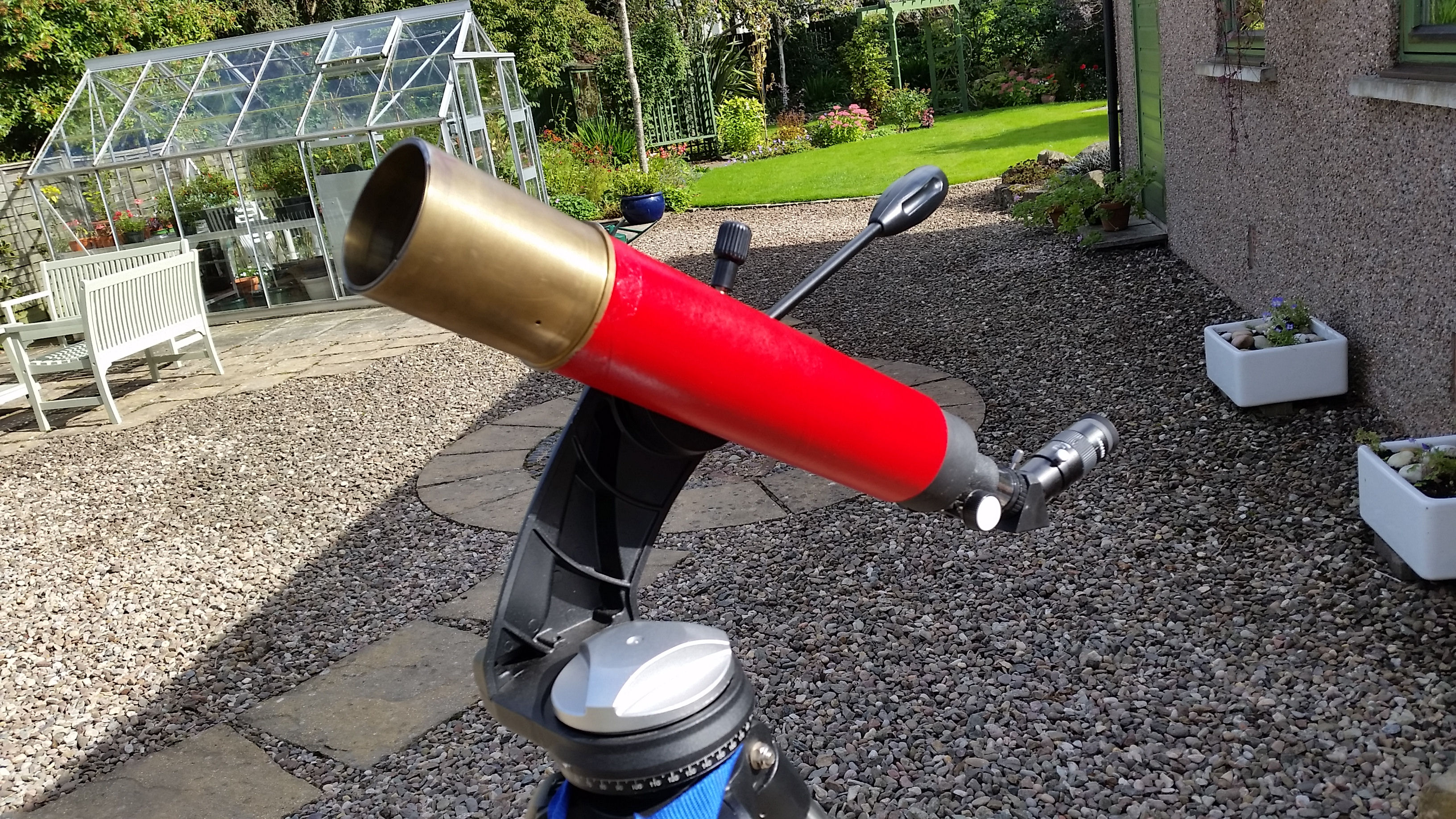 """Showing off my home-made 3"" refractor.  Government surplus object glass (from the late John Braithwaite) cardboard tube and cannibalised bits of telescope.  Oh yes, and some red paint. Unfortunately with it being a new telescope there's no chance of a clear sky tonight.  I can only apologise if you were looking forward to tonight's penumbral eclipse of the Moon."" - Bill"