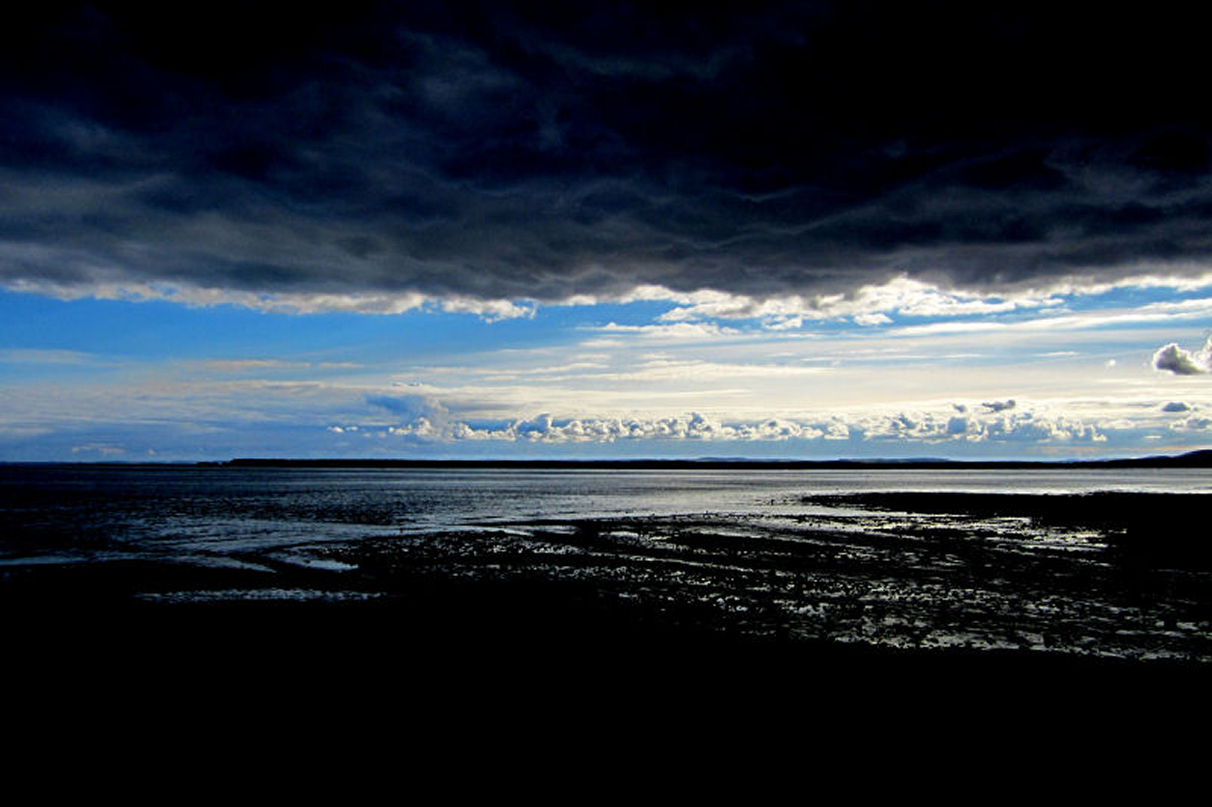 Dramatic clouds over the Tay estuary by Bill Samson. 27.02.2015 15.13pm. Canon IXUS 117 HS f/8 1/640sec  ISO-250 5mm focal length.