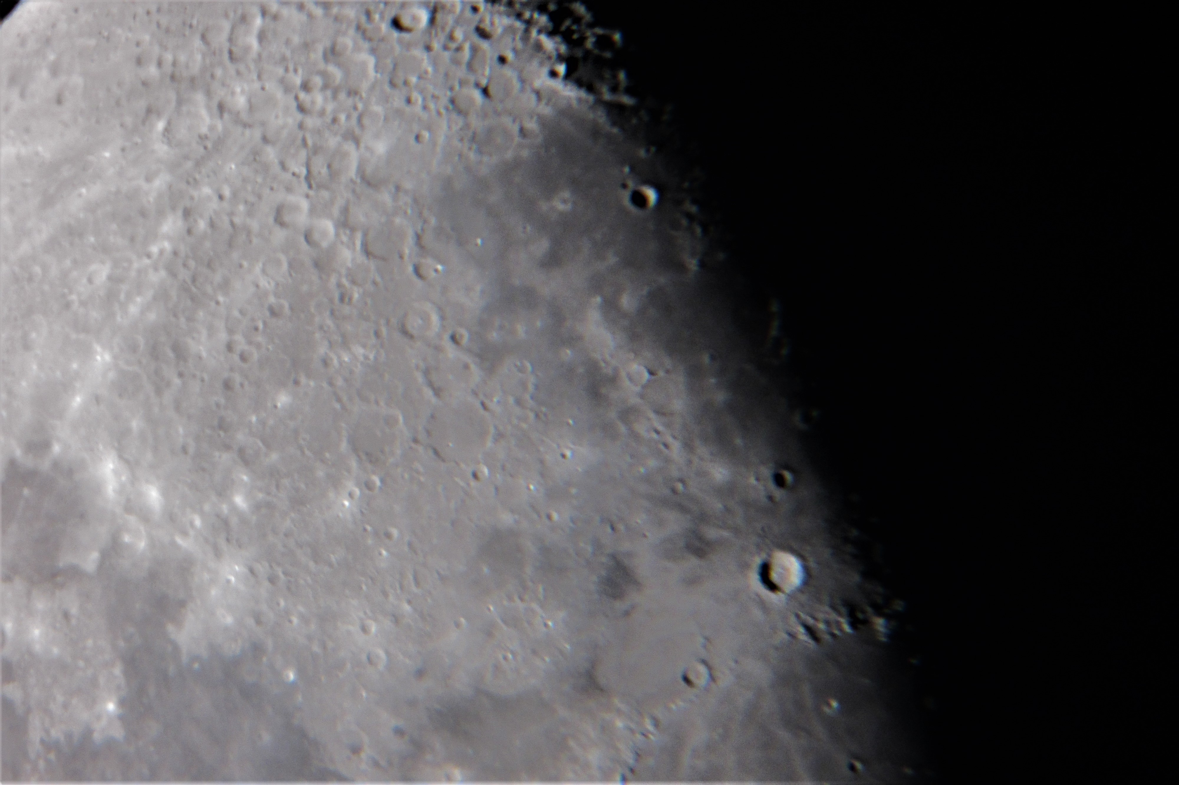 """I took some more afocal moon pics last night (29th October ) at 19:00 UT with my Canon Ixus 117 compact camera clamped to the eyepiece of my 10"" Dobsonian.  Elevation was pretty low and seeing was atrocious."""