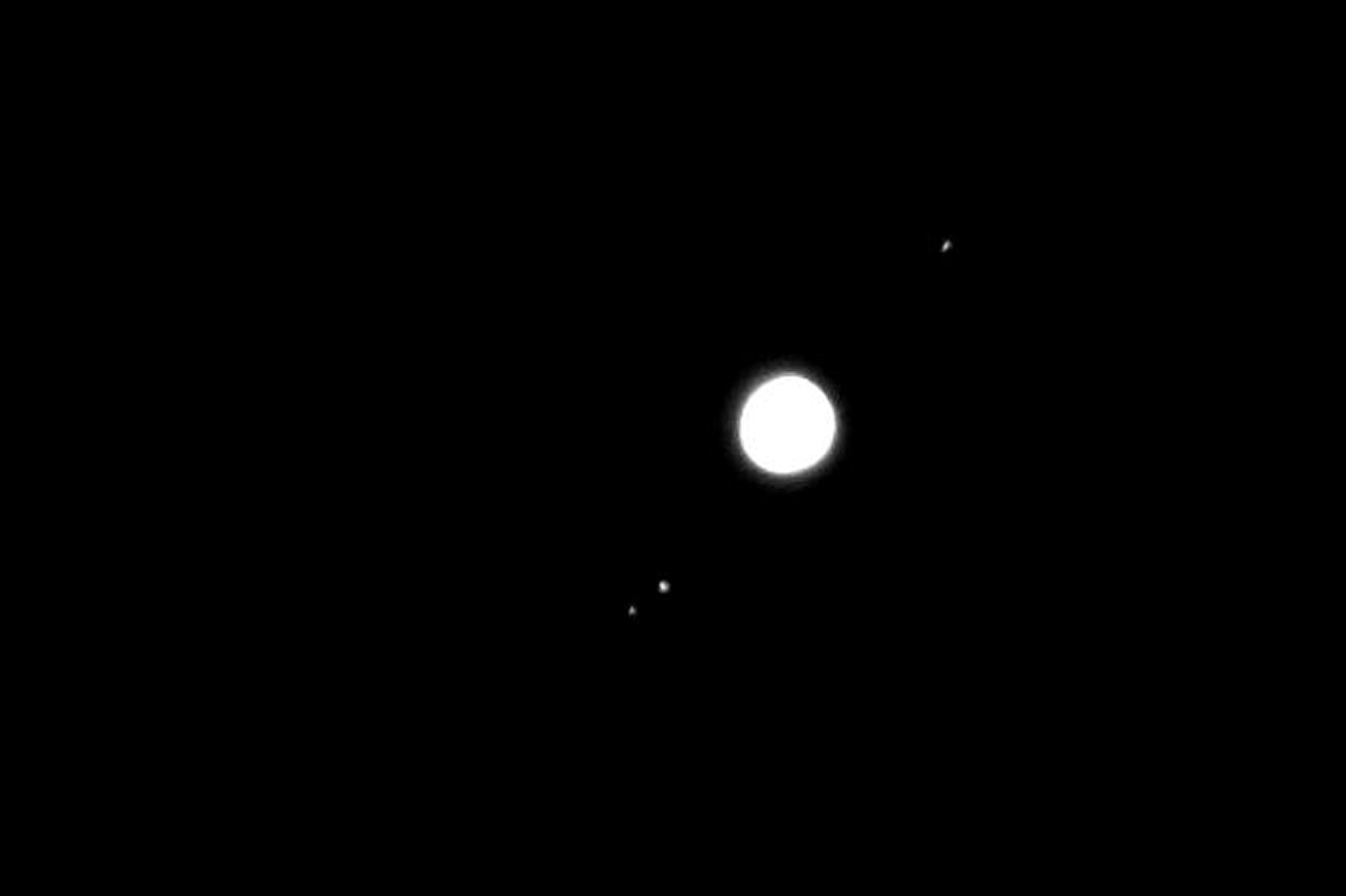 "Jupiter and moons By Bill Samson. 20th March 2015  19.37UT.  Fujifilm XF1, f4.9: 1/5 sec:  ISO-200 23mm focal length.  ""I've now done a bit of tweaking and cropping to my best shots of Jupiter from the other night when everybody else seemed to be clouded out.  I took one to show the cloud belts, and another to show the moons. ""-Bill S"