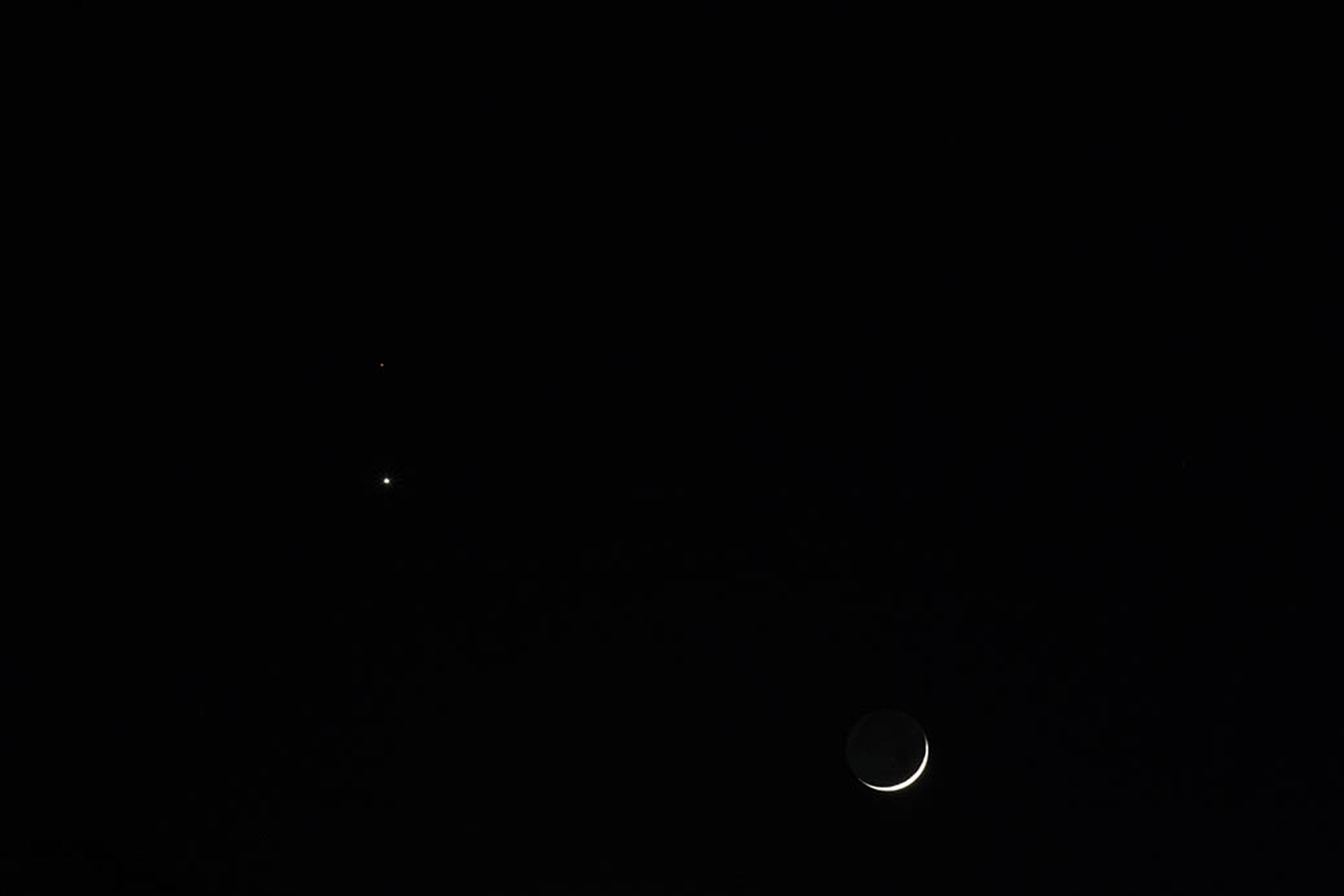 Mars, venus and the Moon By Tony Hayes.  20th February 18.49 UT Year unknown, Canon EOS 1200D. f/22 ISO-6400 1.6 second exposure time. Brightness & contrast adjusted in Photoshop