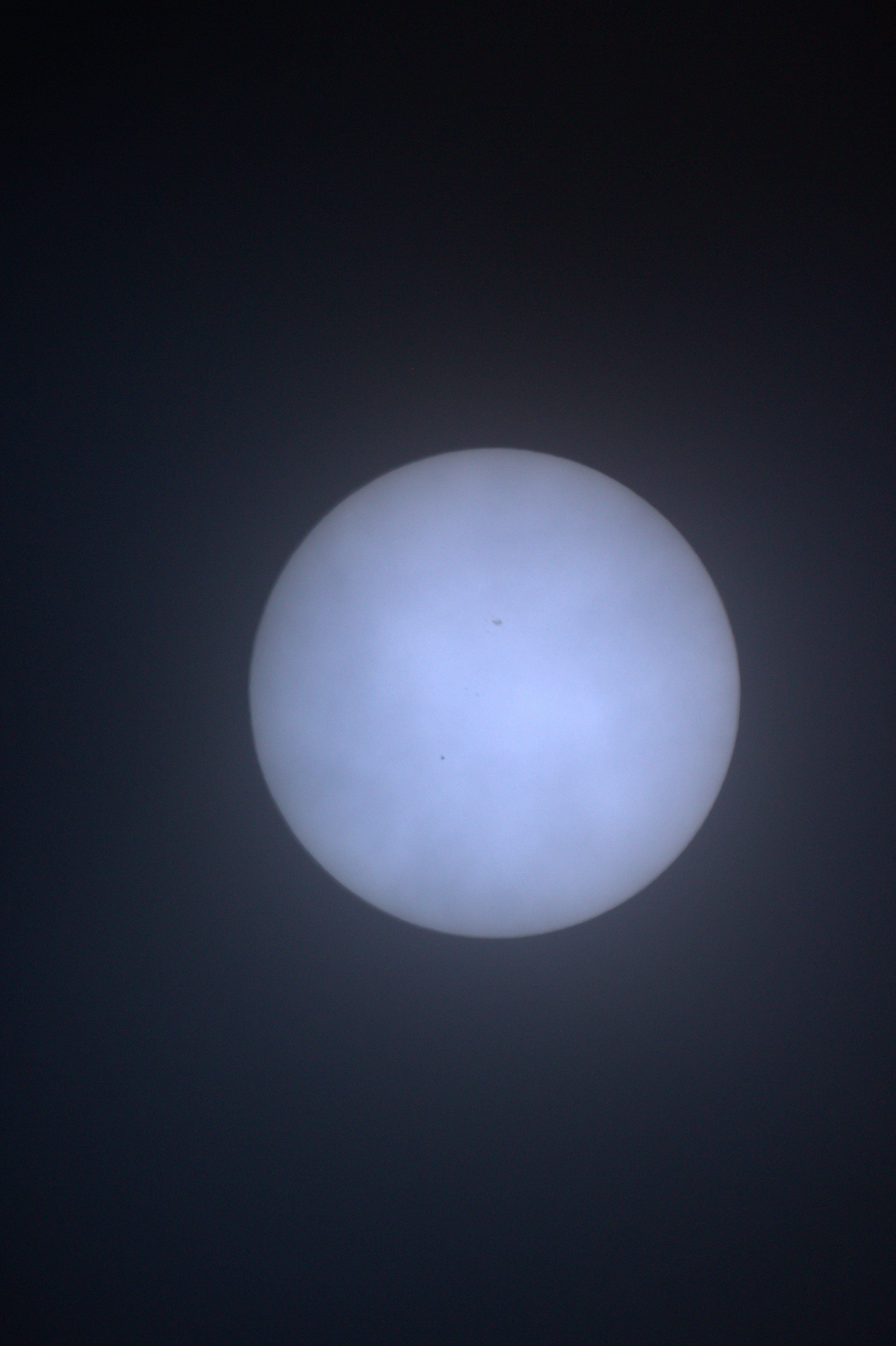 "Mercury transit of the sun 9th May 2016 by Pam Foster. Canon EOS-600D 1/1250 sec:  ISO-800 focal length 50mm. ""Transit through the clouds, in sunny Algarve"""
