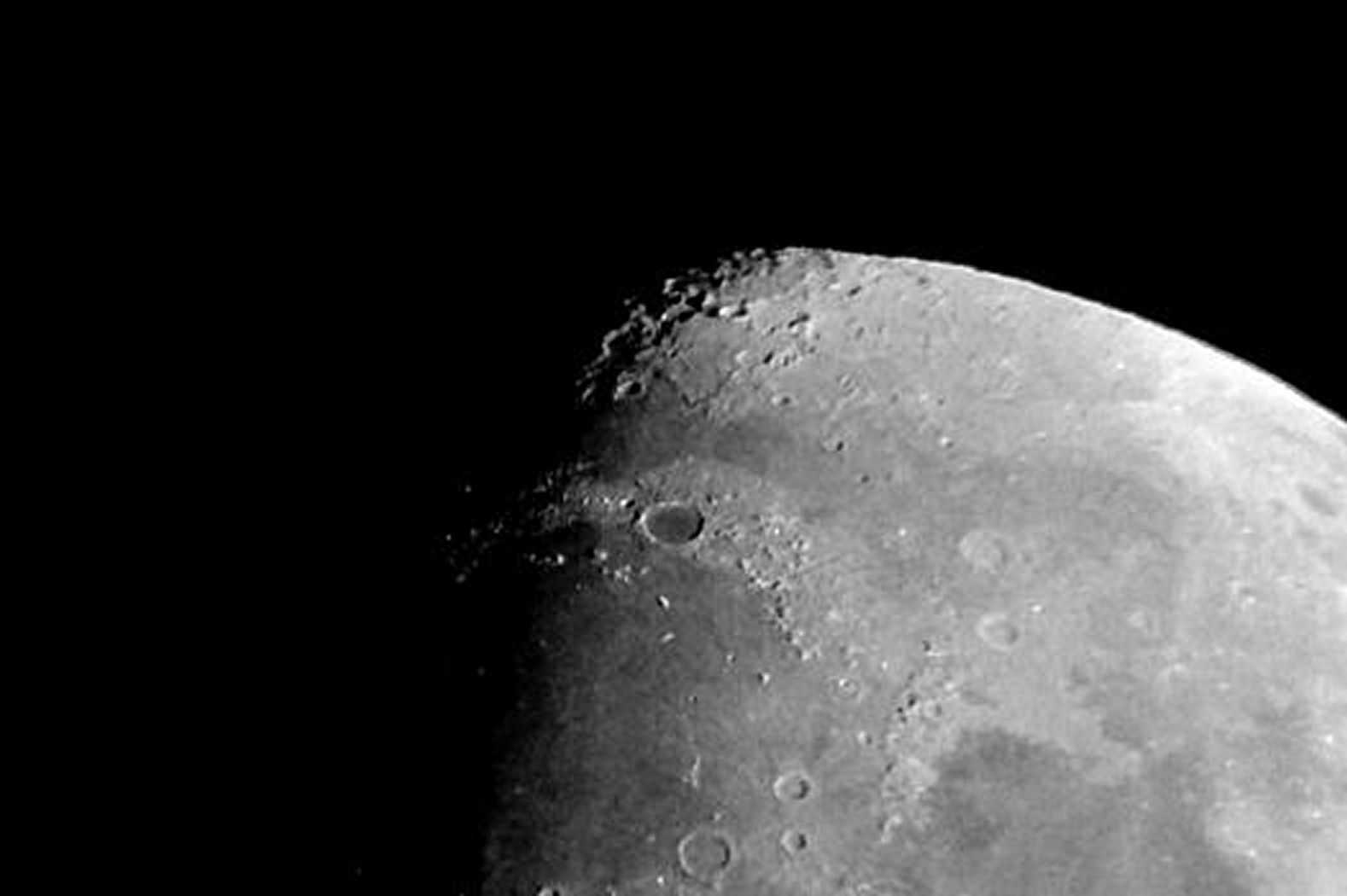 "The Moon by Bill Samson 20th Dec. 2015. ""I took this picture this evening, just after 6pm.  it was taken using a compact Canon Ixus 117 camera at the eyepiece (25mm) of a Skywatcher Skymax 102 Maksutov Cassegrain on a simple undriven mount. """