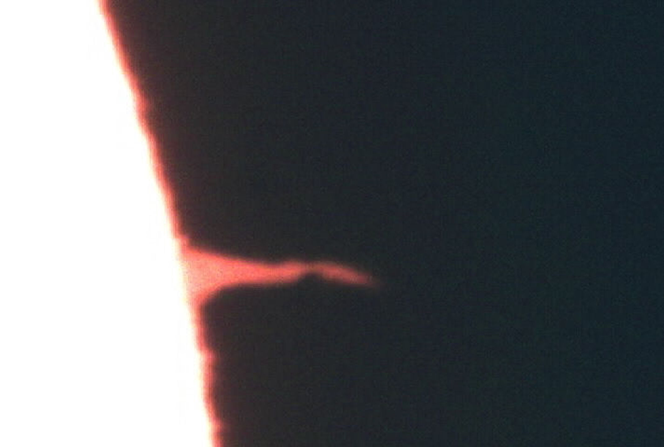 """Solar spike"" by T Hayes. I believe this is the same ""spike"" as the one shown in monochrome on 17th August, but this picture from a video taken on Sunday 16th Aug. at 18.35 local time."